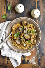 Whole grain spaghetti with mushrooms and eggplants.Top view.