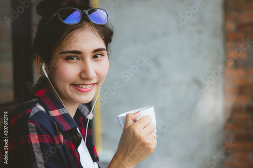 c879917ab513 beautiful Asia woman teen,girl listening to music and drinking coffee with  fun and happy in free time.