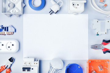 Different electrical tools and equipments with white paper for text.Electrical background.Top view.