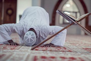 African Muslim Man Making Traditional Prayer To God While Wearing Dishdasha