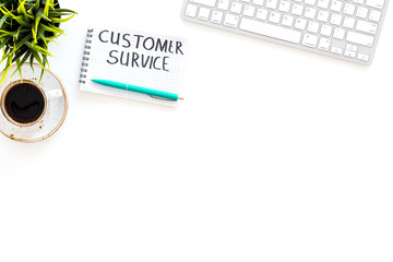 Business problems. Customer service concept. Words customer service written in manager's notebook on work desk on white background top view copy space