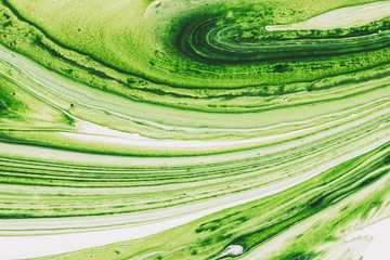 Mixed white and green paint. Abstract background