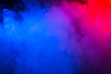 Multi-colored smoke in the form of a cloud on a black background