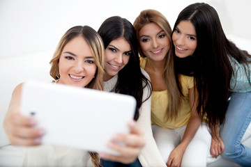Women taking a selfie with a cell phone