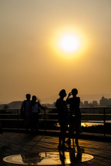 People take the shot at the hill of jingshan park during the sunset, Beijing
