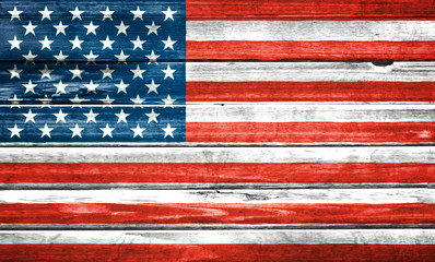 United States of America flag painted over wooden board. Closeup background