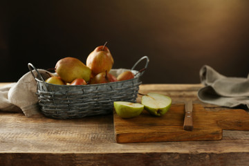 Composition with delicious pears on table