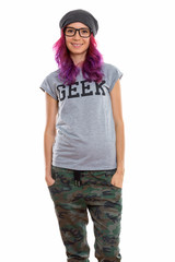 Studio shot of happy geek girl smiling and standing while wearin