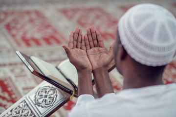 African Muslim Man Making Traditional Prayer To God While Wearing Dishdasha
