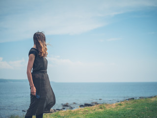 Young woman walking by the coast