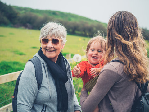 Grandmother with daughter and grandchild outdoors