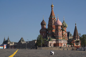 Moscow / Russia – 05.08.2018: horizontal image of a soccer ball on the Red Square in Moscow in front of the Saint Basil's Cathedral, the ball in the middle