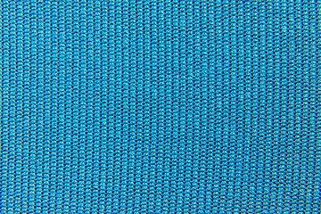 background of a cloth of blue color close-up of an interlacing