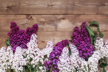 Acrylic Prints Lilac Bouquet of purple lilacs flowers on a brown wooden background