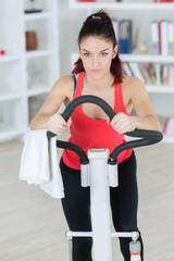 teenager girl exercising on stepper trainer