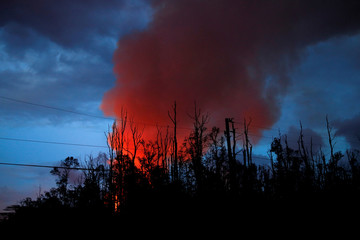 A plume of volcanic emissions rises from a lava fountain in Leilani Estates