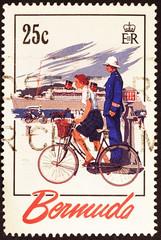 Woman on bike and policeman on postage stamp of Bermuda