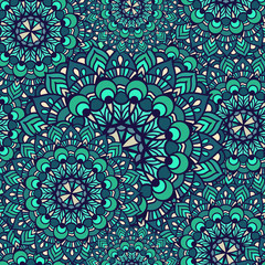 Vector Seamless pattern of circular ornament. The emerald mandala is large and small in the background.