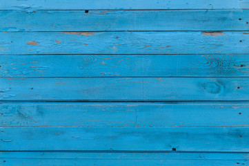 Horizontal background old painted blue board. Vintage texture