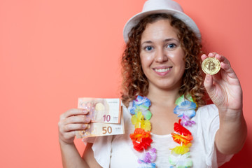 Beautiful traveller woman making a choice between cryptocurrency bitcoin or euro currency