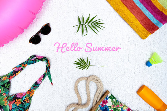 Vacation style postcard concept with Hello Summer title text and summer beach accessories
