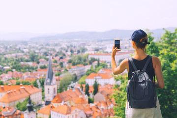 Tourist takes a picture panoramic view city of Ljubljana, Slovenia, Europe