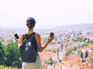 Woman delights panoramic view of Ljubljana City, Slovenia, Europe