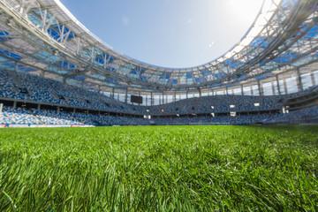 stadium, close up on fresh green grass.