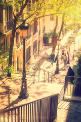 Wall Mural - Typical Montmartre staircase and old street lamp, golden sunny light in Paris France
