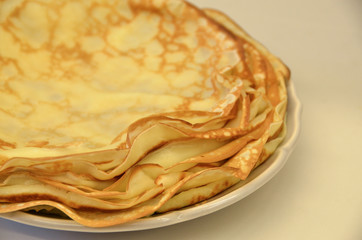 Blini. Tasty Russian pancakes on white table. Close up