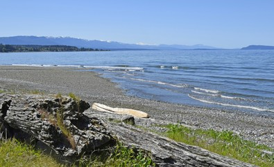 view over the Georgia Strait from Qualicum Beach on a sunny day with blue sky, Vancouver Island  British Columbia Canada