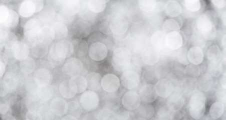 Grey bokeh with white color abstract background can be use as wallpaper