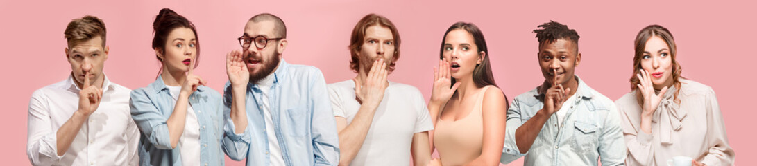The young men and women whispering a secret behind hands over pink background