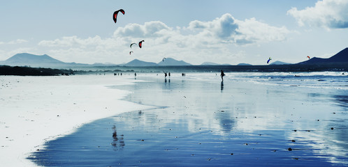 kitesurfers at Famara Beach in Lanzarote, Spain.