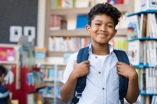 Smiling hispanic boy at school