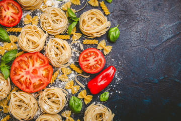 Pasta and fresh vegetables scattered in flour