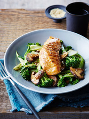 Miso and maple glazed salmon on stir fried asian greens, close-up
