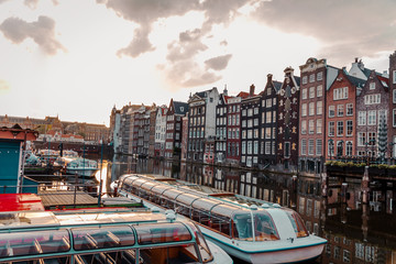 sunrise over the traditional Amsterdam houses on the Domarik canal