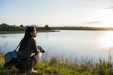 Young female tourist looking out over river in Kruger National Park, South Africa