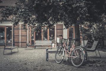 Vintage pink bicycle under the tree