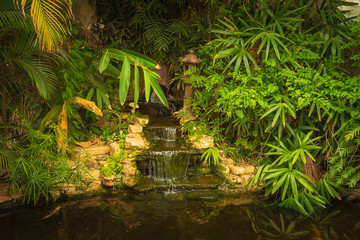 Mysterious waterfall in decorative pond