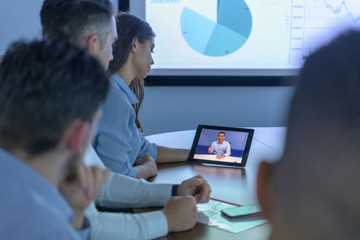 Business team with video conference with digital tablet during business meeting