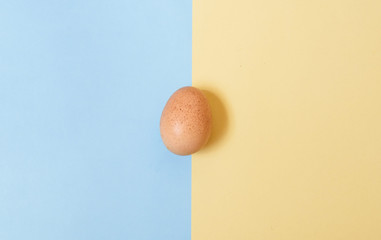 egg on  blue and yellow background