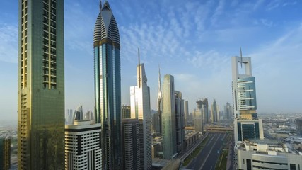 Fototapete - Day time lapse of Dubai downtown with moving clouds
