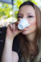 Woman drinking Turkish coffee