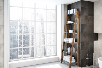 Shelves with towels in a loft bathroom