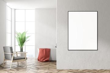 White tub in a white bathroom, armchair, poster