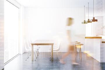Concrete floor dining room interior, woman