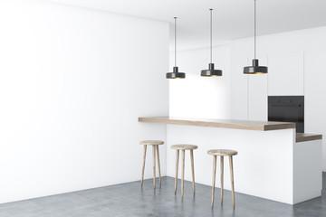 White kitchen corner with a bar