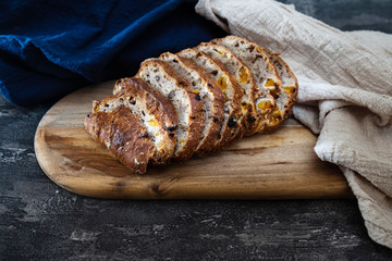 Fototapete - baked French bread on wooden table